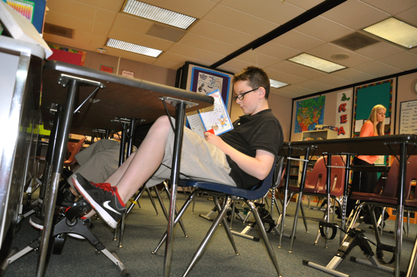South Pointe Middle School special education students have begun reading and riding using stationary pedals to improve reading skills. (Photo Courtesy:  Kelli Gile)