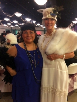 """(Photo Courtesy:  Randi Hauser) Rosa Zuniga-Green and Historic Preservation Commissioner, Denise Lynn Sutherland dressing the part at the """"Moonshine & Valentines"""" event."""