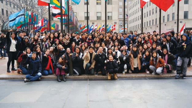 (Photo Courtesy:  Kelli Gile) The 140-member Diamond Bar High School Symphony Orchestra celebrates their 1st place Orchestra Cup award while sightseeing at New York City's Rockefeller Center.