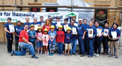 Photo Courtesy:  WVUSD Together we can make a difference! C.J. Morris Elementary third graders delivered lunches to Habitat for Humanity volunteers on May 23. Shown with teacher Lisa Peterson.