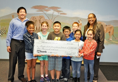 Photo Courtesy:  Kelli Gile Diamond Bar Friends of the Library presented a $1,000 donation for new library books at Maple Hill Elementary (shown with President Chris Ko, Principal Nancy Stingley and students).