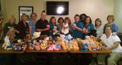 Photo By: Raymond Mendoza GFWC Federated East Valley Women's Club President Mary Matson (center) stands with her members and their donation of stuffed animals, which was given to Volunteer Chaplain Carol Gardner (fourth from the left) for San Antonio Regional Hospital's program of comforting hospital-ridden children and the elderly.