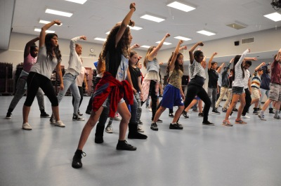 Photo courtesy: Walnut Valley Unified School District Suzanne Middle School drama students rehearse alongside the internationally acclaimed Young Americans.  Over 2,000 students from eight schools will come together to perform Turn it Up So Cal on Dec. 1 at the Citizens Business Bank Arena in Ontario.