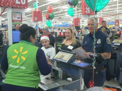Photo courtesy: CVUSD A Walmart employee checks out a student and his chaperones.