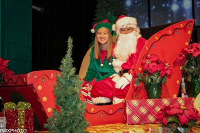 Photo by: Paul Moureaux of pmxphotography.com Santa and his elf Haley are ready to take pictures with the kids.
