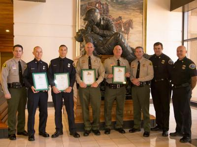 Deputies honored for their life-saving actions pictured with Sheriff McMahon.