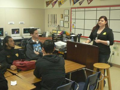 Photo courtesy: CVUSD Brianna Smith Gunn (right), a 2008 Don Lugo High graduate, talks to Don Lugo seniors about her experience in the Army.