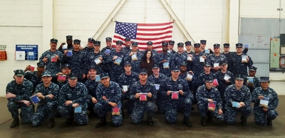 Photos courtesy of CVUSD Caitlyn Broad surrounded by Navy sailors and the goodie bags she made them