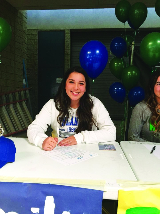 Courtesy of Facebook Emily Nguyen signs her letter of intent to Finlandia University in Michigan.