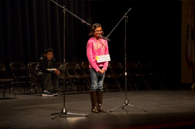 Photo courtesy: CNUSD  Aisha Randhawa of Garretson Elementary spells out her winning word to claim the District's Spelling Bee title.