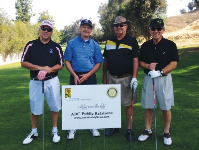 "Photo by: Sarah Sanchez Steve Almquist, Pastor Mark Hopper, Jack Penzes, and Al Smith at last year's ""Golf Fore The Kids"" event."