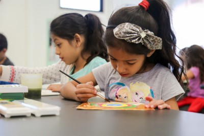 Photo courtesy: CNUSD A CNUSD student uses Crayola products to paint.