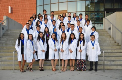 Photo courtesy: Kelli Gile  Forty-Walnut High seniors were presented with white coats and honor medallions at the completion of the IBCC-PLTW program.
