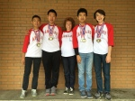Photo courtesy: Kelli Gile Suzanne Middle School MATHCOUNTS coach Amy Erickson congratulates gold medal winners Tyler Xu, William Lin, Darren Chen, and Clement Chan.