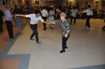 Photo courtesy: Kelli Gile Walnut High students paired up with local seniors for a Lindy Hop dance lesson. Shown: Freshman Brian Duran teaches community member Leann Curren some new steps.