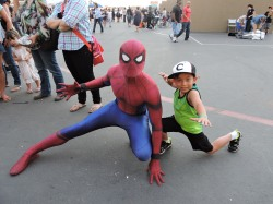 Adrian Prado looks up to Spider-Man, as he posed just like him.
