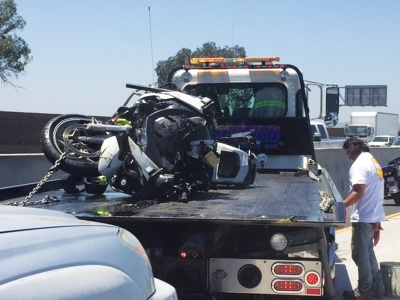 An LAPD officer's damaged motorcycle after crash on 60 freeway.