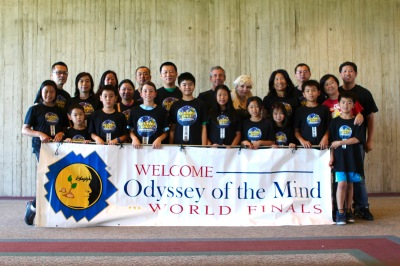 Photo courtesy: Kelli Gile Evergreen students, parents, coaches, and principal Carolyn Wills at the Odyssey of the Mind world finals held at Iowa State University.