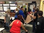 """CVUSD staff members participate in the ALICE Training to prevent an """"intruder"""" from entering the room."""
