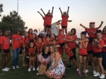 Photo courtesy: JCSD Local Synergy cheer and dance team posed with 3-year-old Finley Smallwood and her mom Christina at the 65th Street LIVE Concert in the Park in Eastvale. The event was organized by JCSD so the community could dance for Finley and help raise money for her surgery.