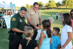 Photo courtesy: City of Chino Hills Deputy Franco and Deputy Arden share school supplies with kids.