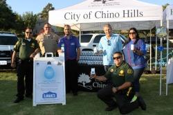 Photo courtesy: City of Chino Hills ):   Sergeant Venegas, Deputy Arden, Juan Isas, Mayor Art Bennett, Deputy Franco, and Sonia Martin Del Campo