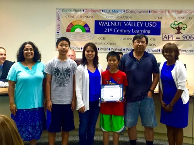 Young artist Michael Wu was recognized by the Board of Trustees on July 13. Shown with teacher Seema Bagai, family members, and Board President Helen Hall.