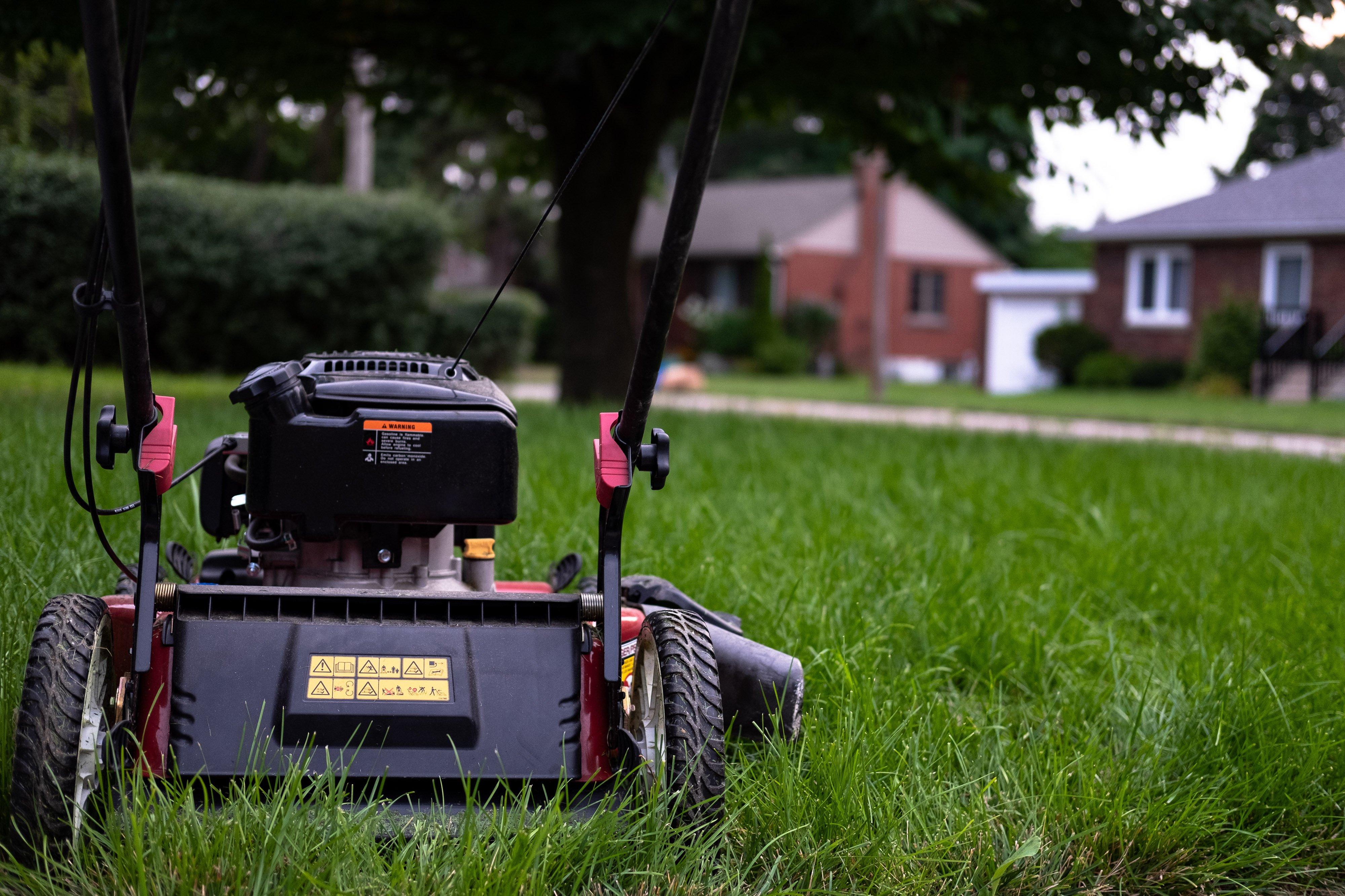 Cvr.Eastvale.lawn-mower-sitting-on-grass_4460x4460